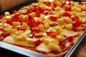 pinapple pepper and mozza pizza ready for the oven