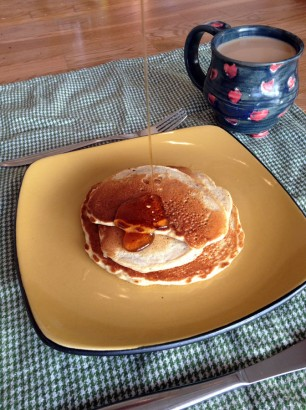 real maple syrup pouring on pancakes